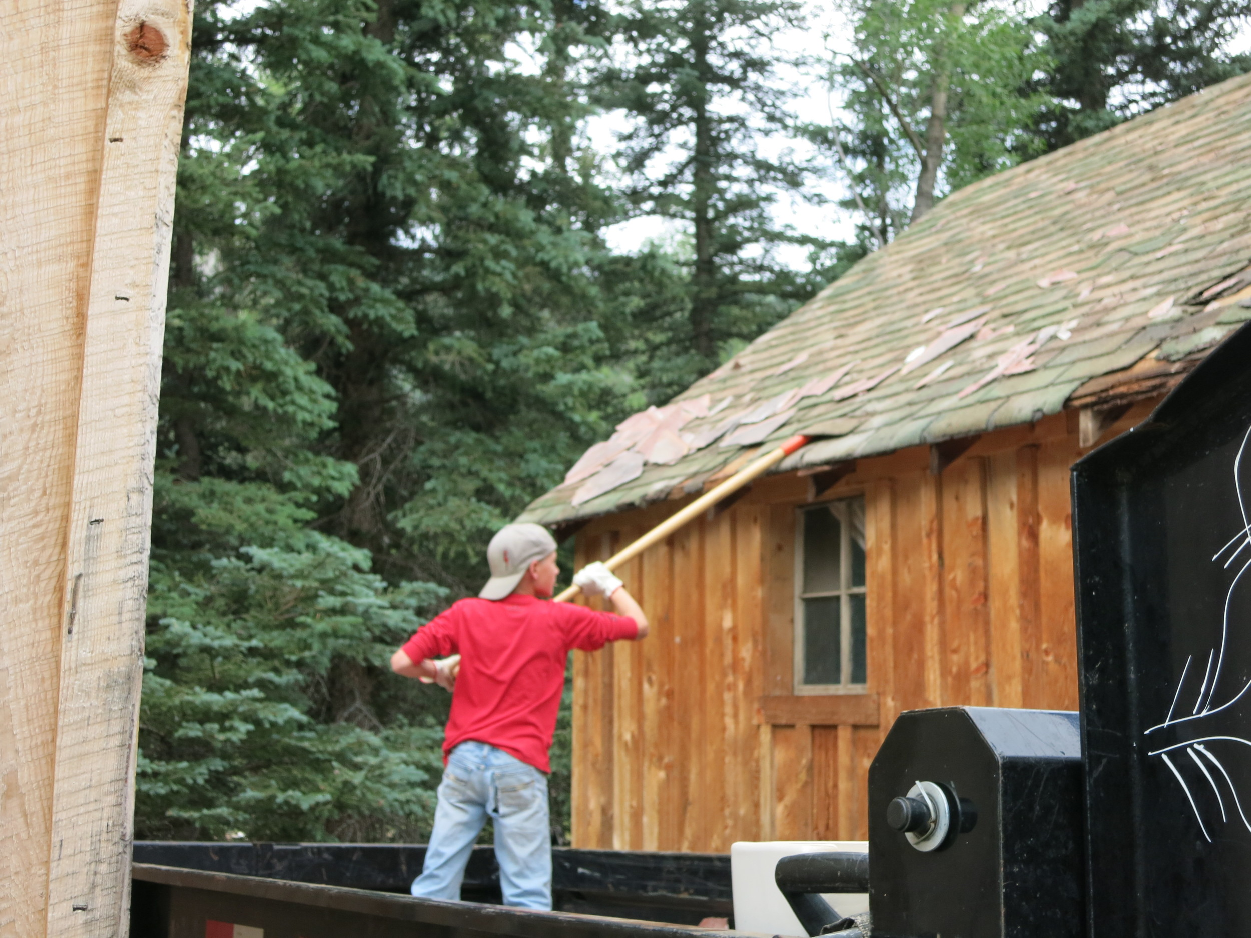 Removing the old roof from cabins