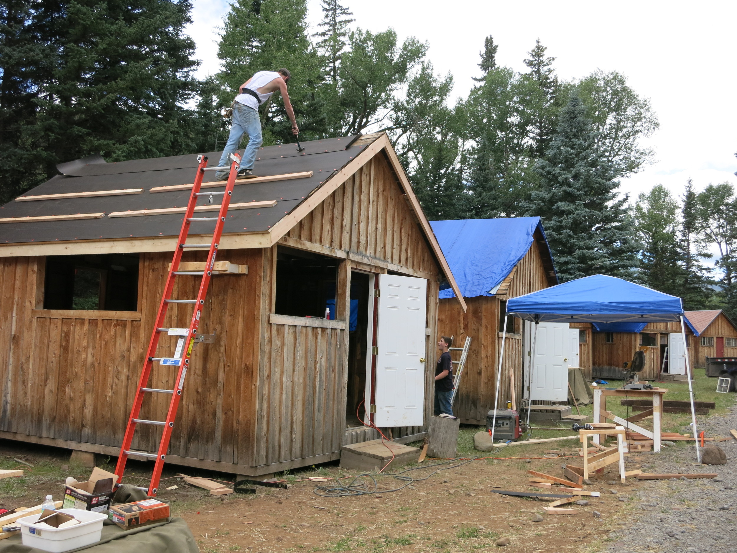 Installing new roof on cabins
