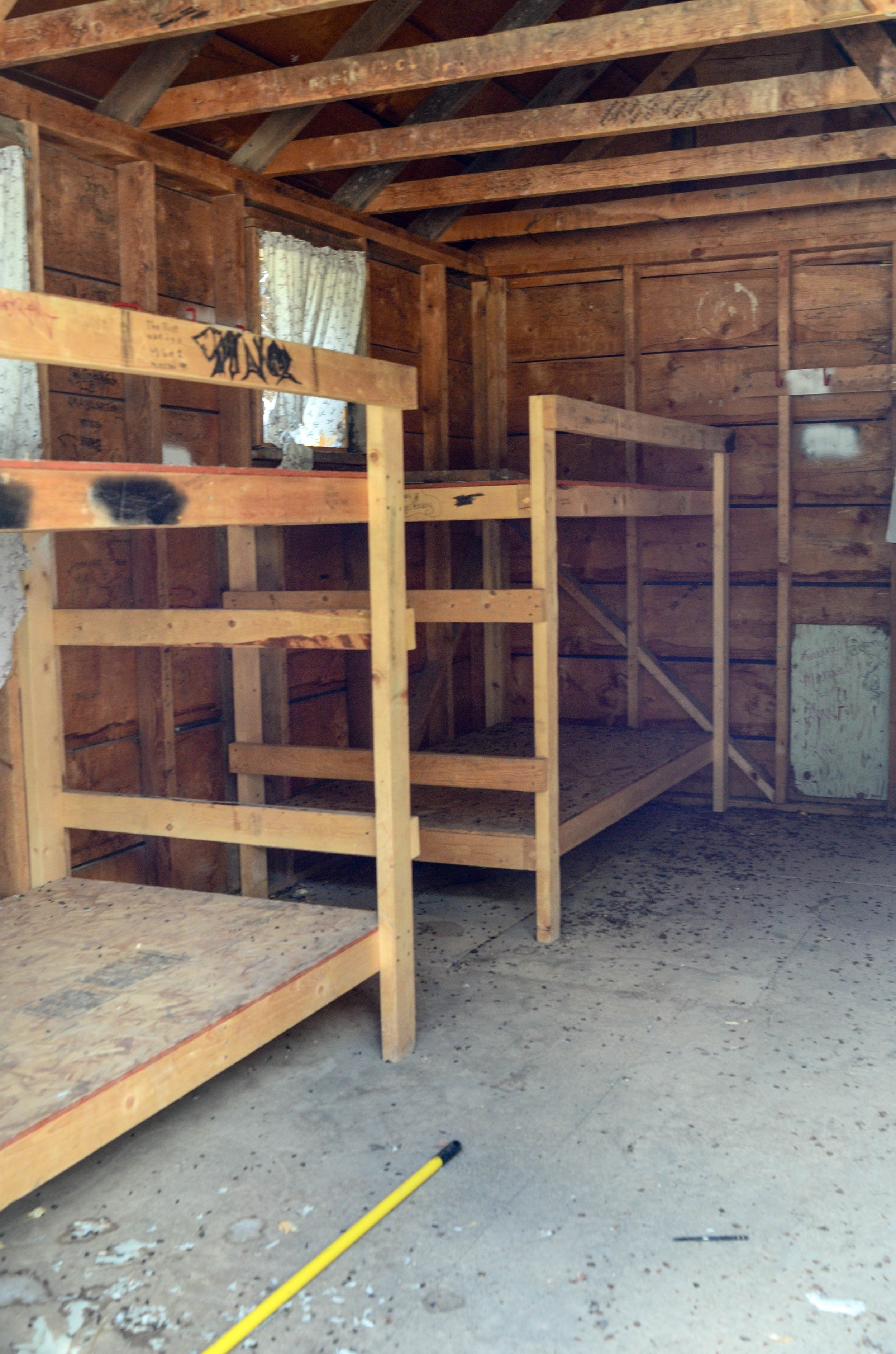 Old bunk beds inside cabins
