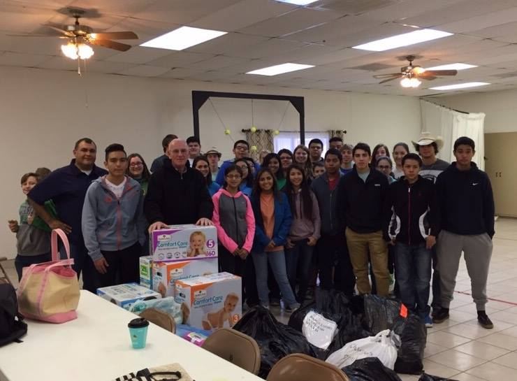 This is Brother Dennis Carrol with the youth that went on the mission trip in 2015. Missionary Carrol is standing behind the boxes of pampers.