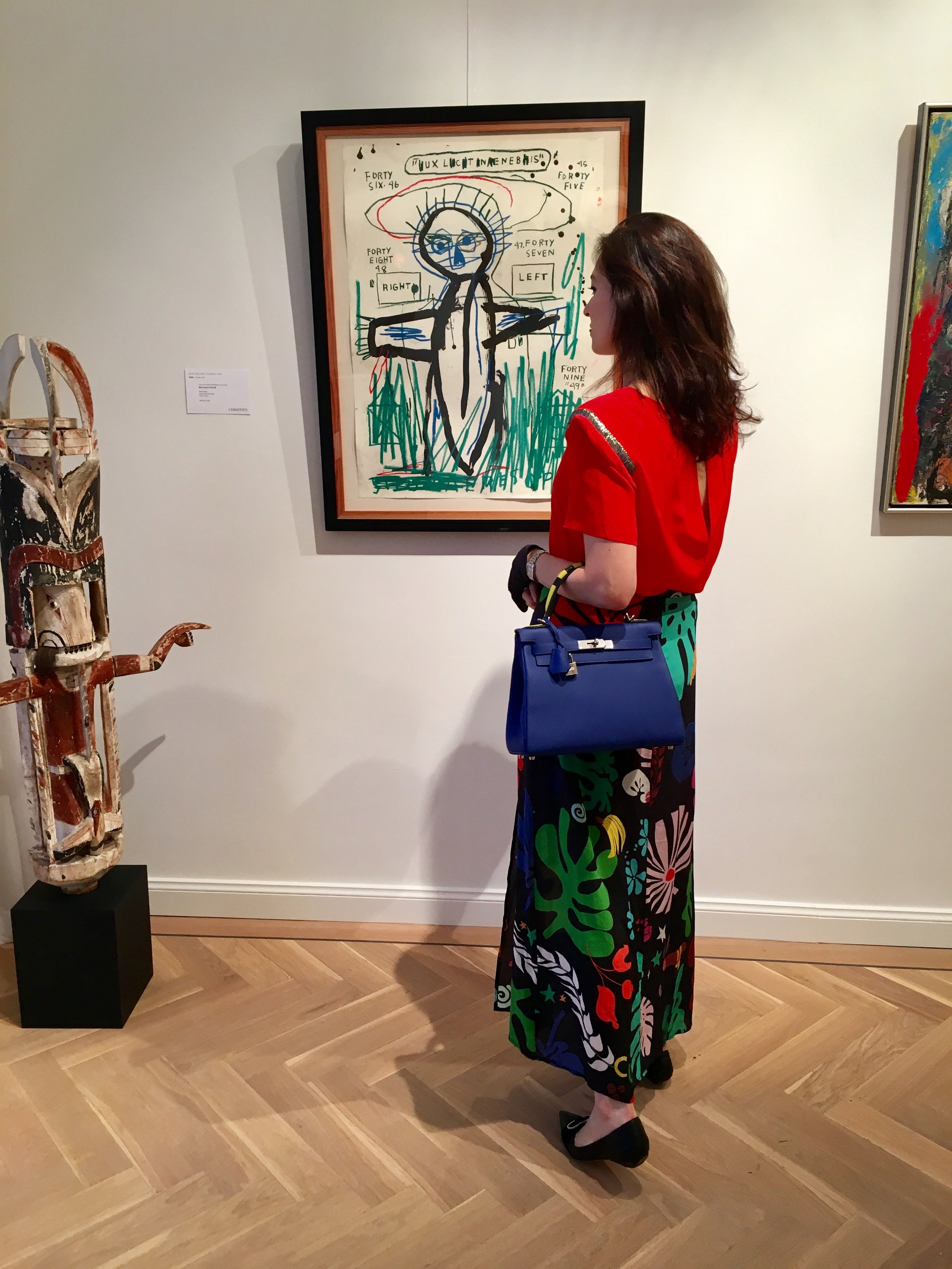 Rachel Koffsky carrying a Hermès Kelly at Christie's