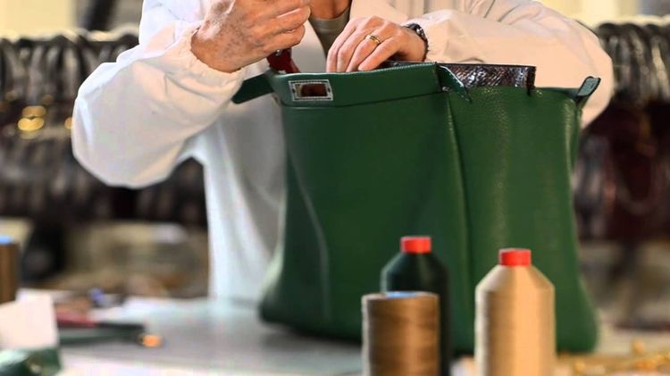 A Fendi artisan crafting the Peekaboo bag