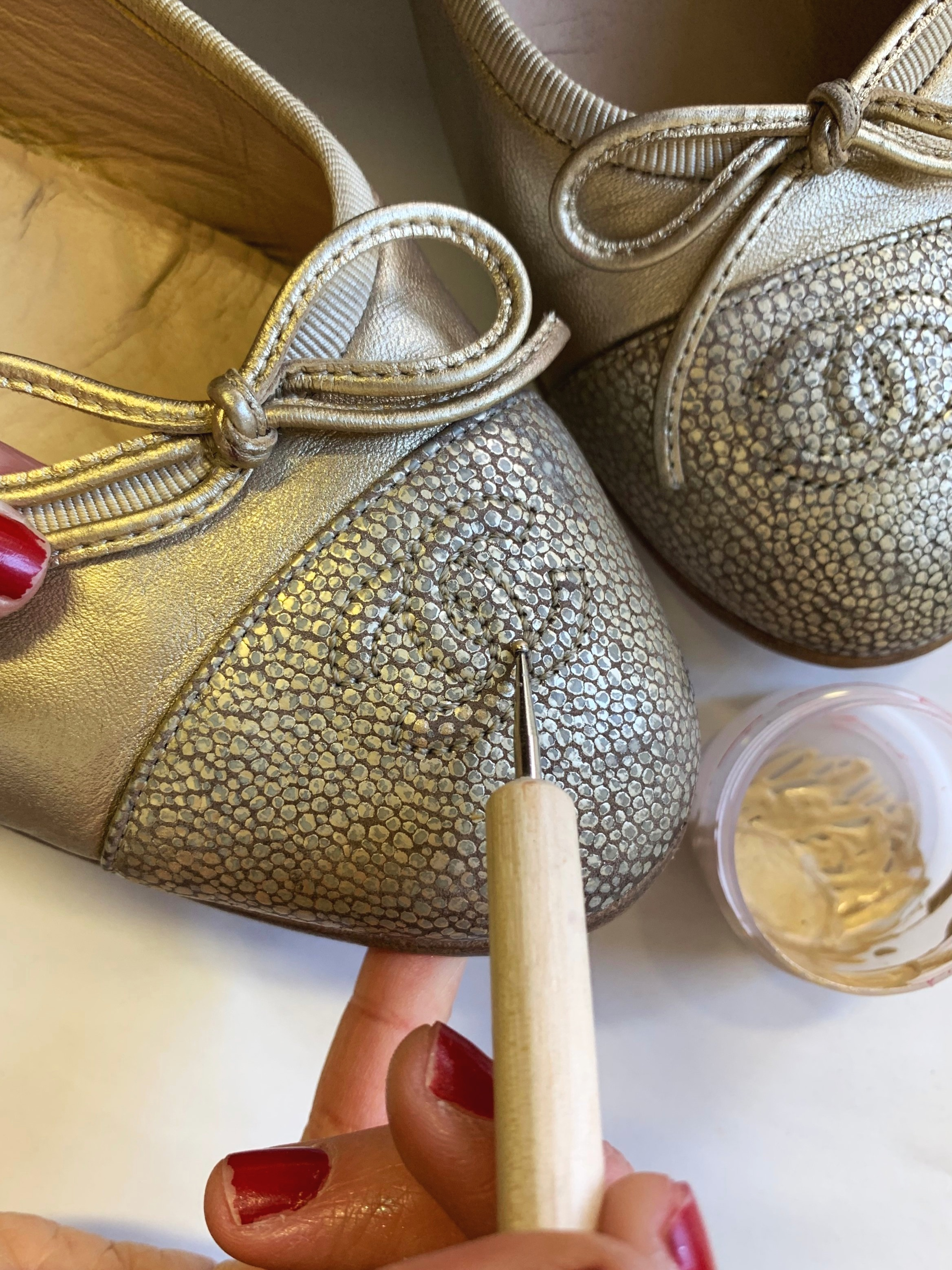 Restoring the gold spots by hand