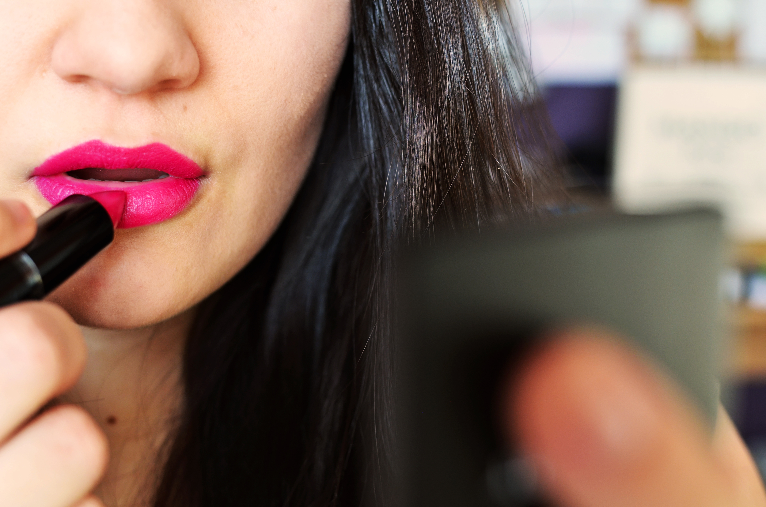hot pink bold lip color application