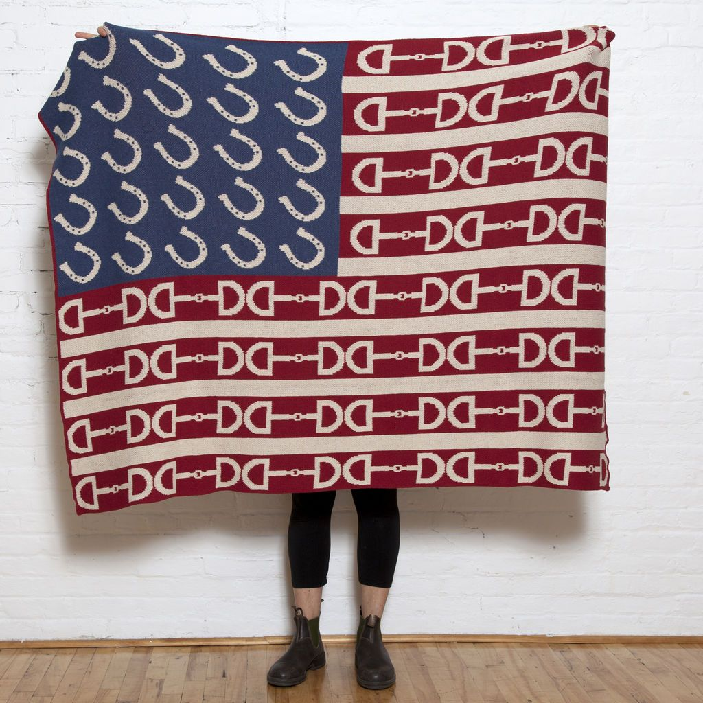 Equestrian Flag Throw - $195Americana is grounded from its equestrian roots, and in this flag blanket, the two are woven together beautifully. Our flag throw is knit in a recycled-cotton blend yarn, and USA made.Size: 50 x 60 inchesContents: 100% recycled polyester (more than 78 plastic water bottles!)Machine washable.Flax, Red and Denim Blue.Made in the USABUY NOW