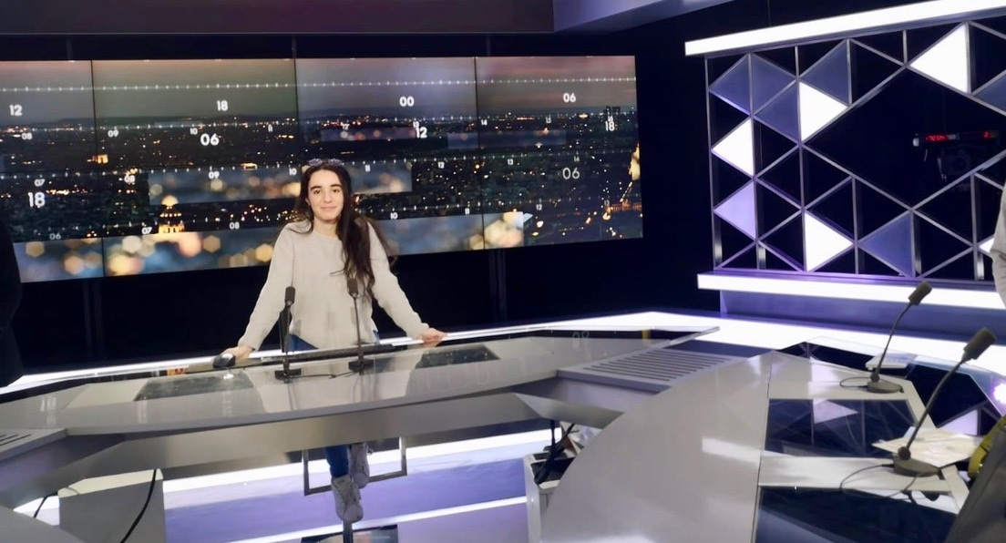 Amina is pictured on the set of CNews in France