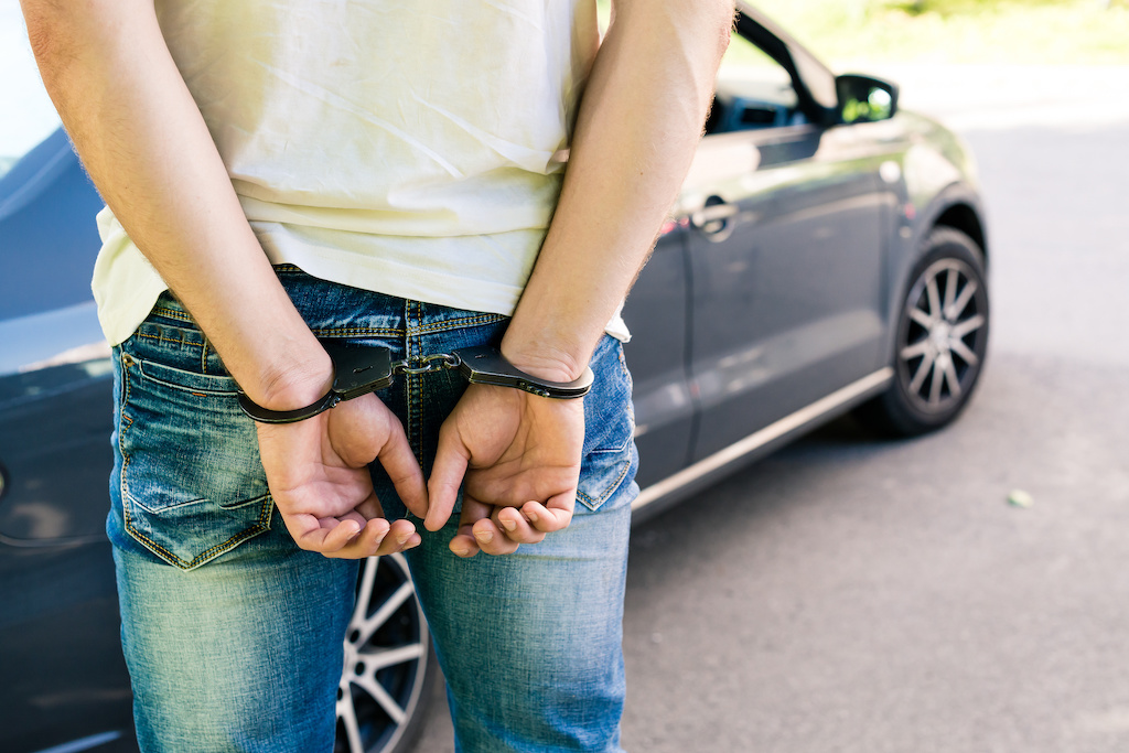 Arrested next to car - Charged With Driving While Suspended/Revoked in California |The Law Offices of Bryan R. Kazarian - Los Angeles County Criminal Defense Attorneys - property, juvenile, petty theft, DUI, misdemeanor, and felony Criminal Law