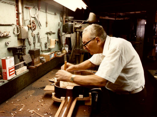 Mario Maccaferri in the late 80's at work on his D-Shape Guitar. The same guitar on display at the Metropolitan Museum of Art in 2011(below)