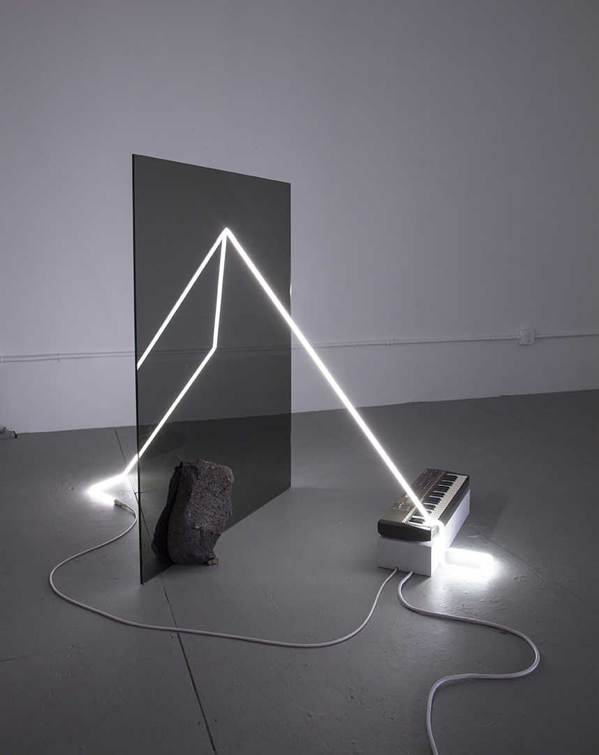 in defiance of being here #10, 2016  neon, plexiglass, Casiotone MT-68 keyboard, rocks, dimensions variable