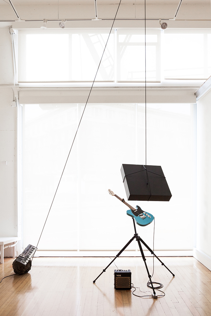 contingency of an afterthought, 2016  chromogenic transparency in light box, Fender Squire Telecaster guitar, Casiotone MT-68 keyboard, tripod, Vox amplifier, Electro-Harmonics Freeze pedal, rocks, dimensions variable