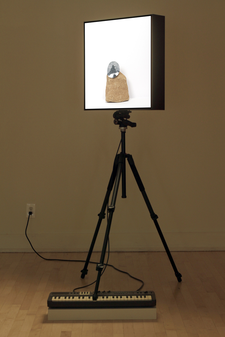 """a paradox in distance (inverted) #4, 2014   chromogenic transparency in light box , Casiotone MT-68 keyboard, tripod, dimensions variable (light box: 24"""" x 24"""" x 5"""")"""