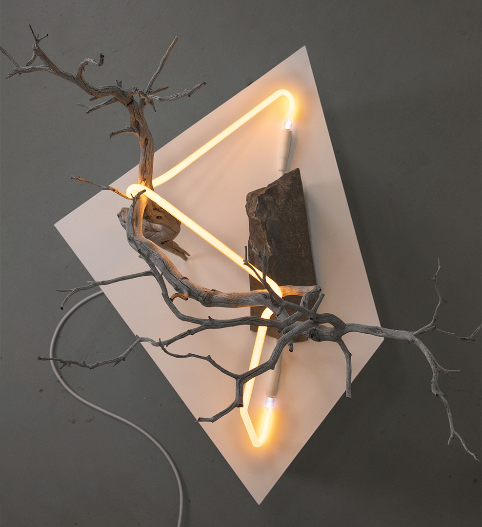 """an outline of a thought as it refers to its inner self #3, 2018  neon, found branch, modified rock, custom shaped pedestal, 57cm x 111cm x 51cm / 22.5"""" x 43.5"""" x 20"""""""