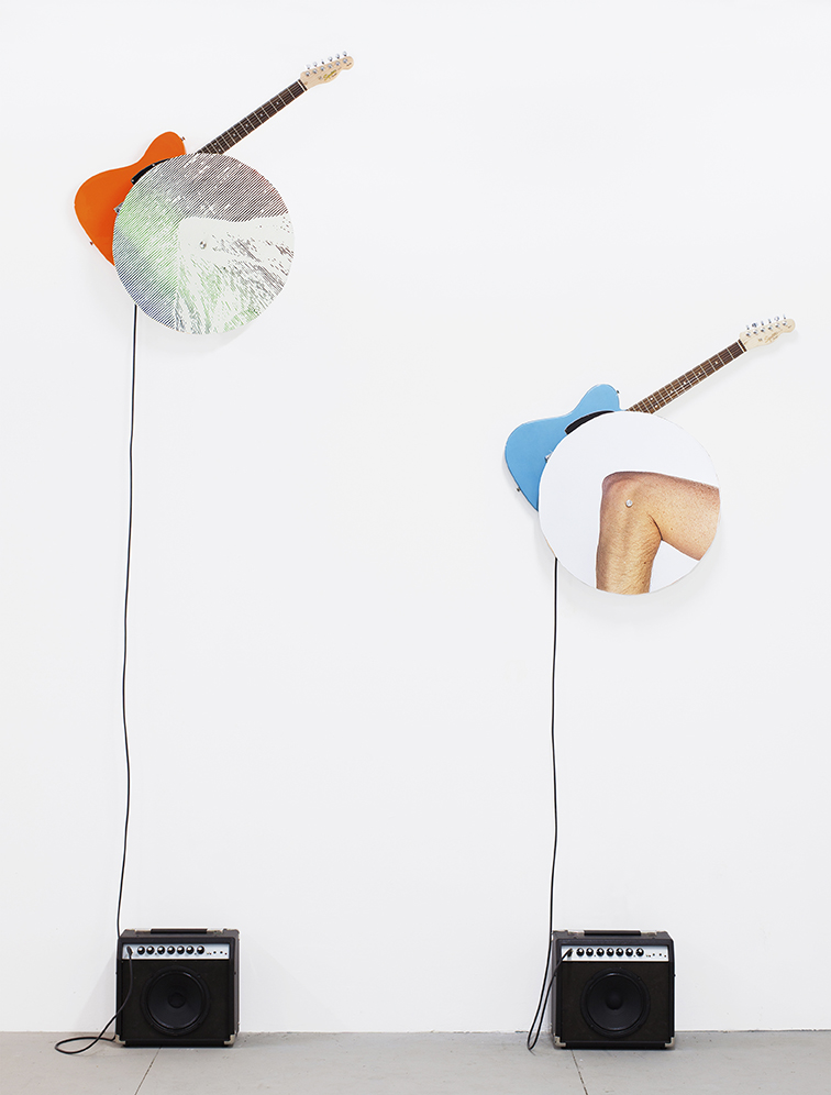 "rotational relevance, 2019  two inkjet prints, cast acrylic, guitars, amplifiers, cables, rotating motors, 221cm x 297cm x19cm / 87"" x 117"" x 7.5"""
