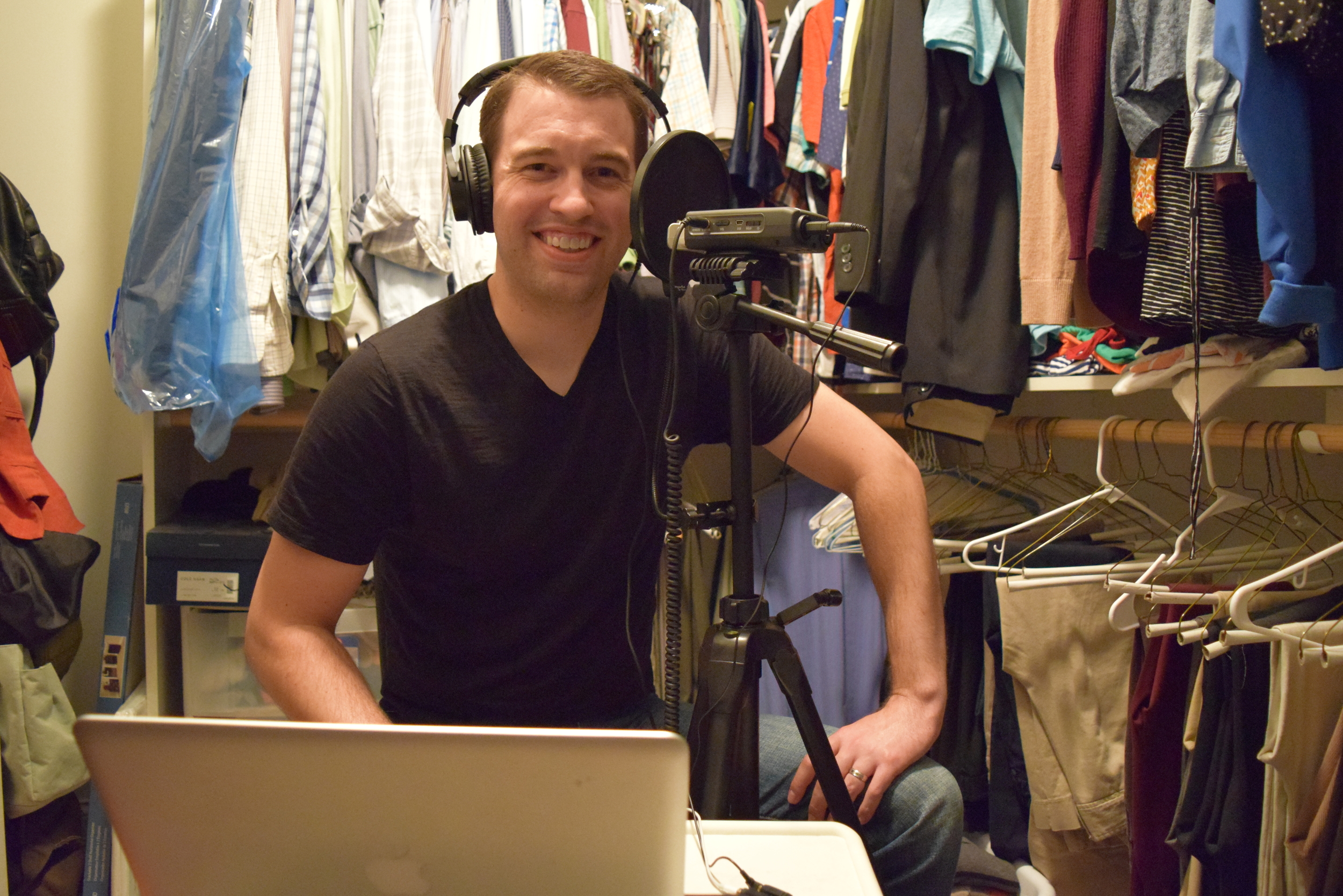 Yes, I am recording in my walk-in closet. It's by far the quietest room in the house, and the clothes actually do a great job of reducing echo. I wanted a picture of this first interview so I can compare someday when I've made some equipment upgrades.