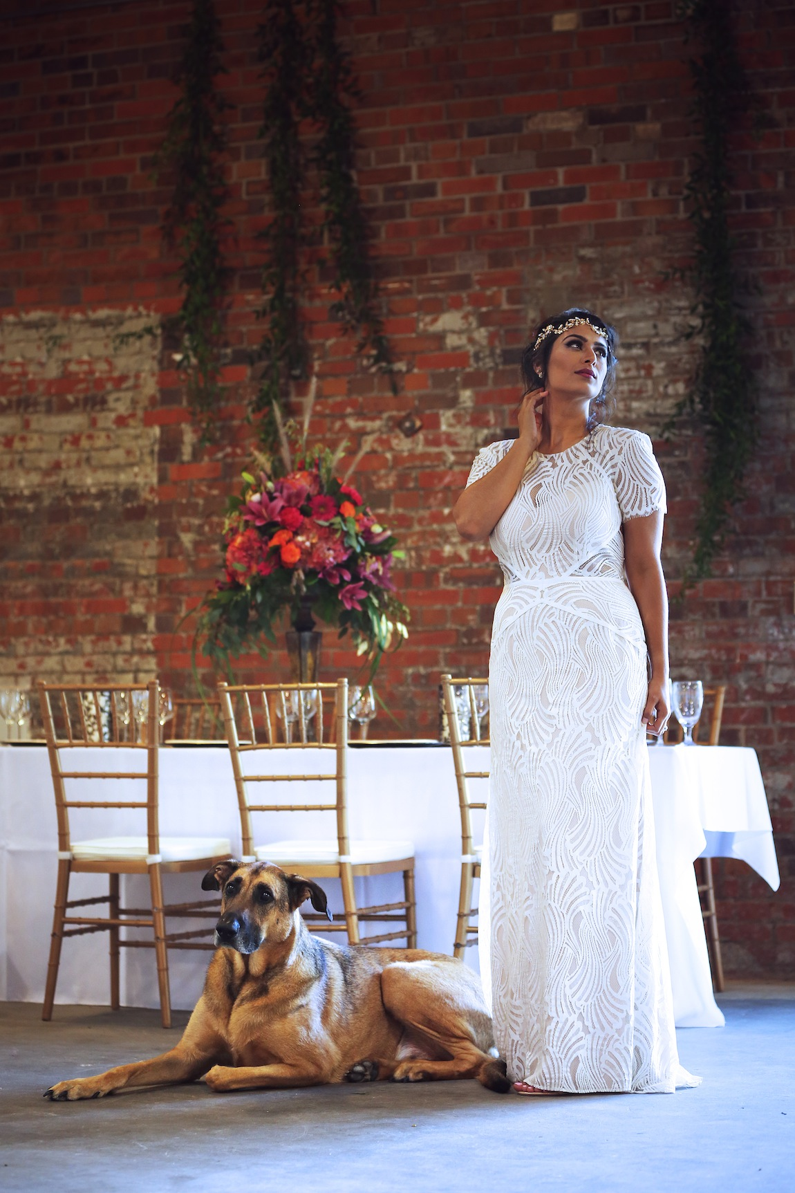 Photo of a bride with a dog showcasing our wedding venue