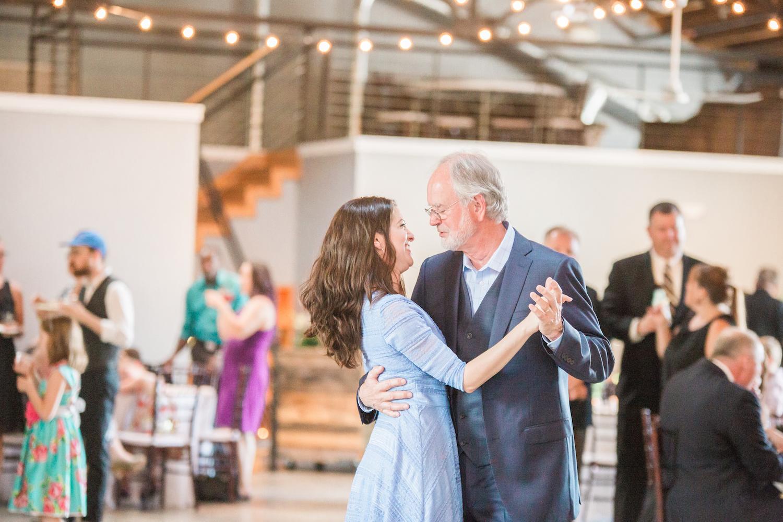 Happy couple in big banquet hall