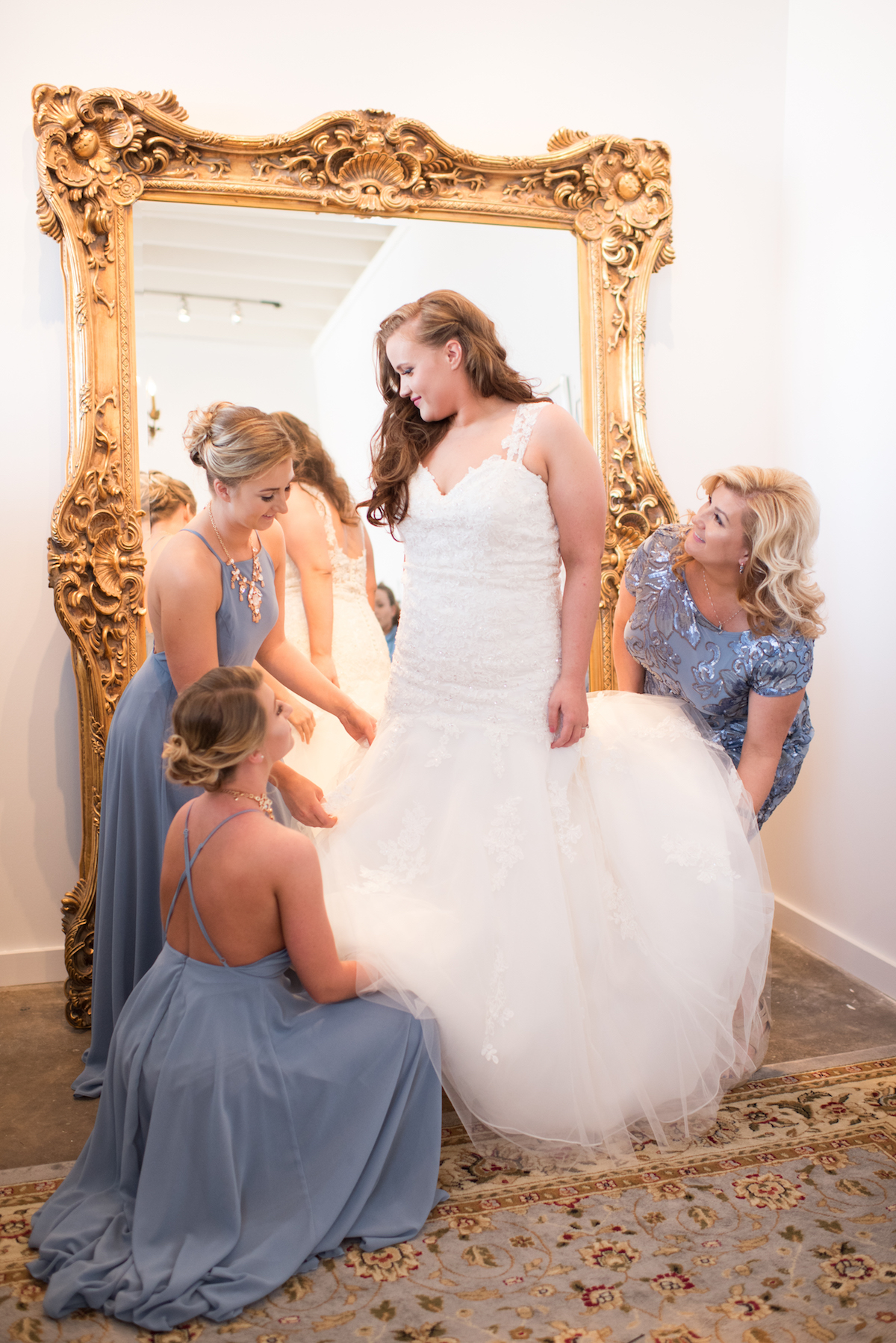 Taryn in front of the luxurious full size mirror in the bridal suite