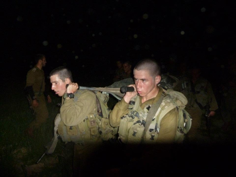 Nothing fun or health about stretcher carry...Final march before joining the combat platoon.