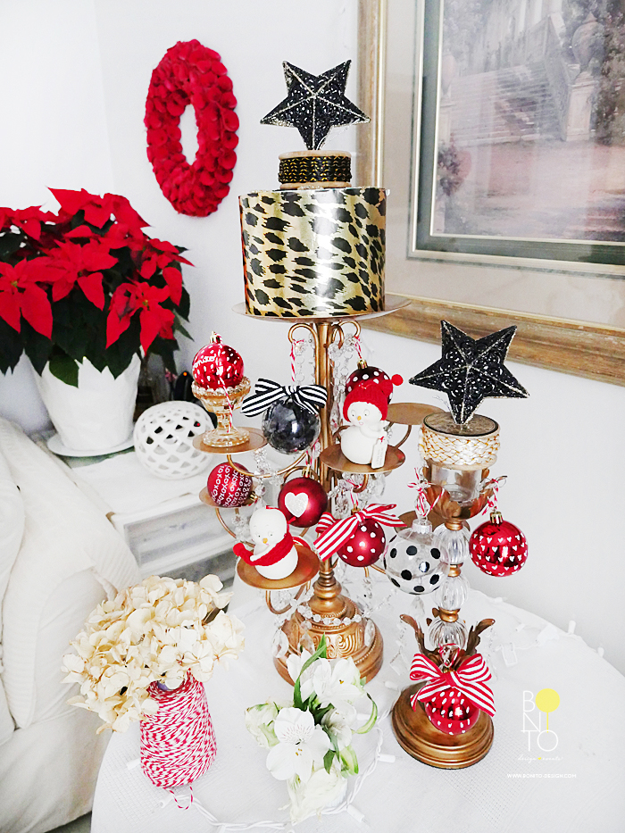 """A New York City Gal has to be creative at times with space. I converted this Candle Holder Chandelier to a """"Christmas Tree."""" Combining Classic Red for the Holidays with Black and Gold colors."""