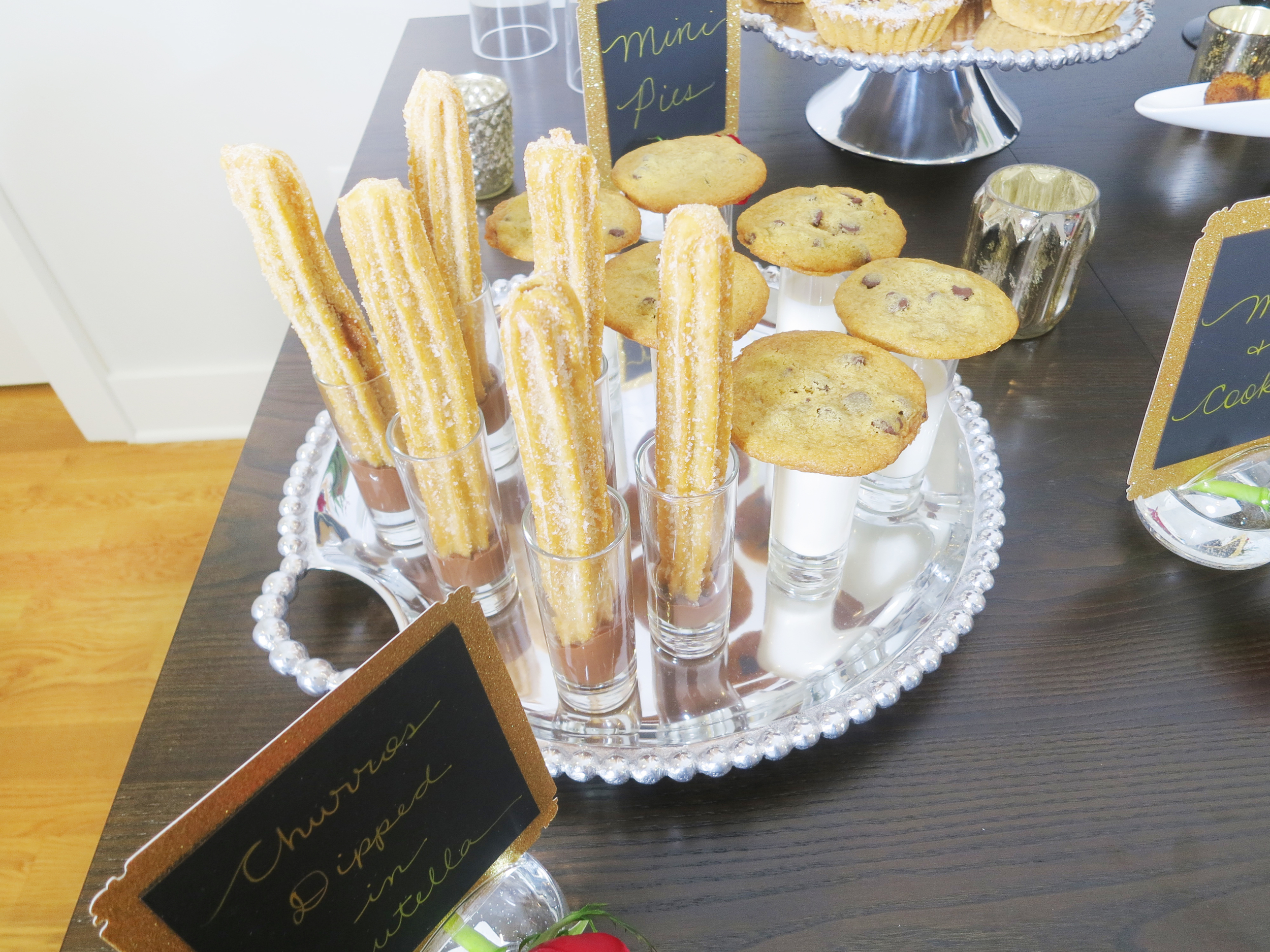 Yummy Churros Dipped in Nutella, Mini Pies, Milk and Cookies will definitely have your guests gaga.