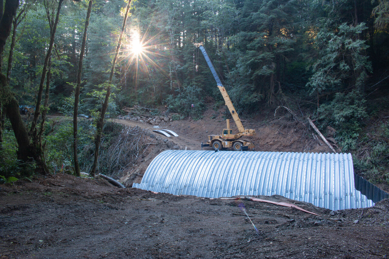Installation of the last few segments of the new culvert.