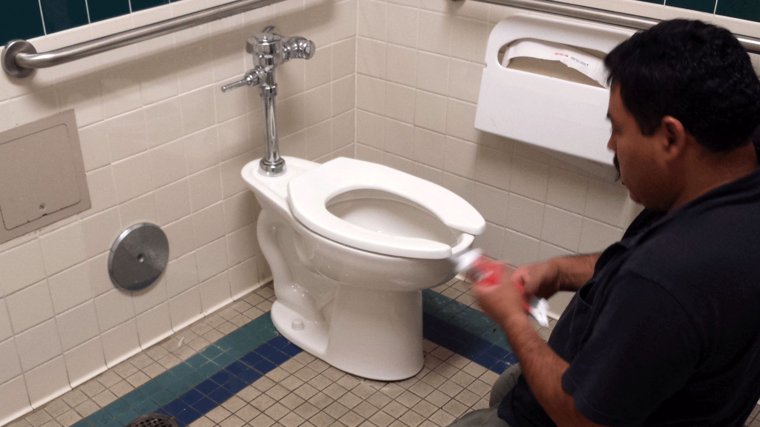 Installing toilets at a commercial location after hours.