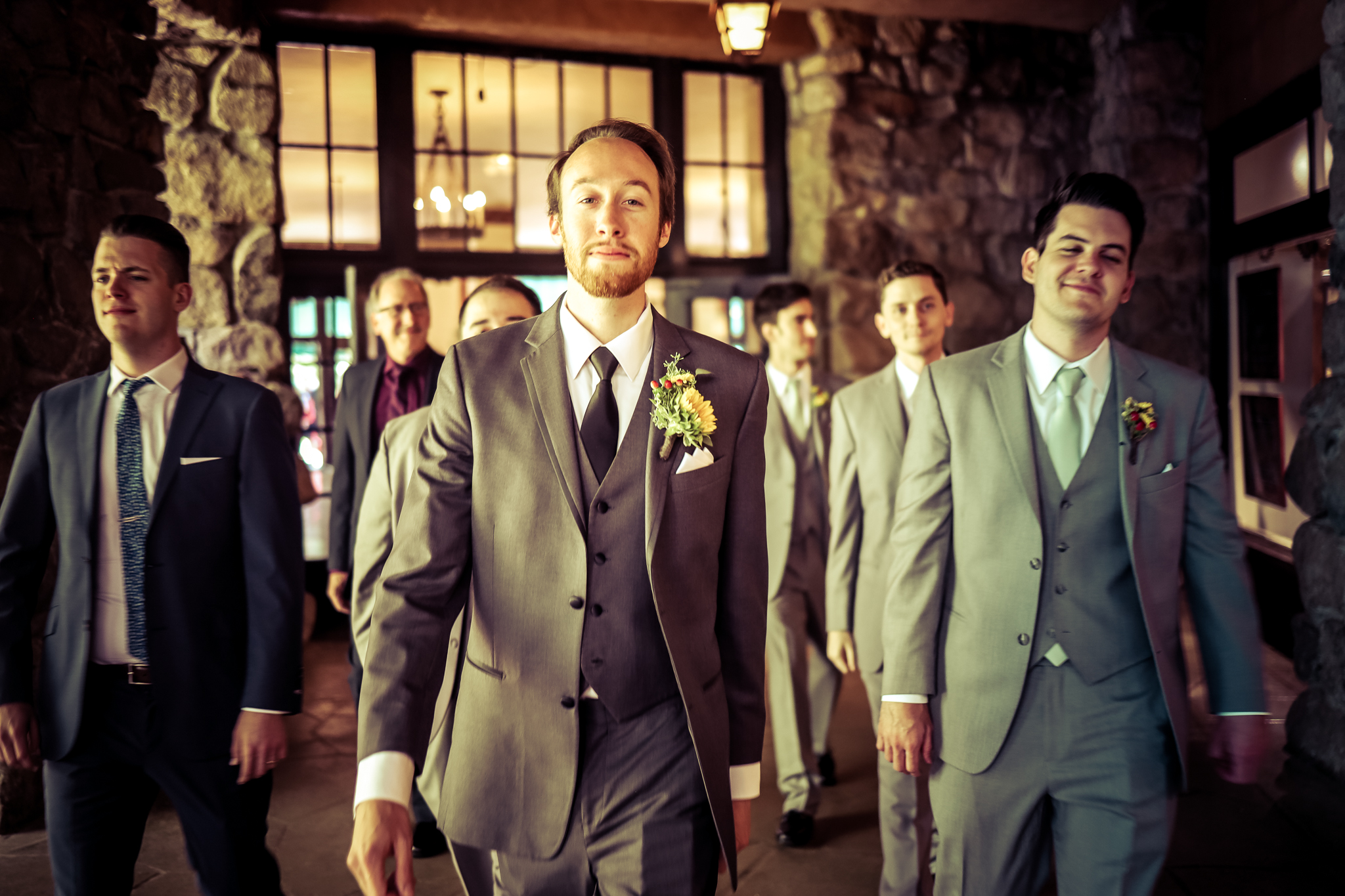 photo of groom at lake majestic yosemite hotel