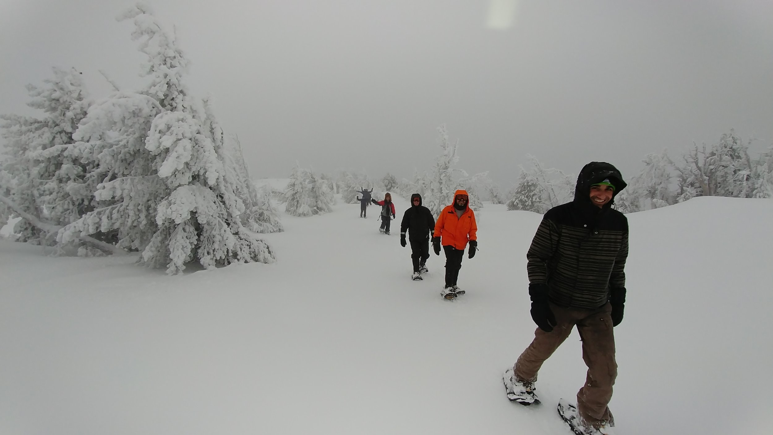 Snowshoeing to the summit - all smiles.
