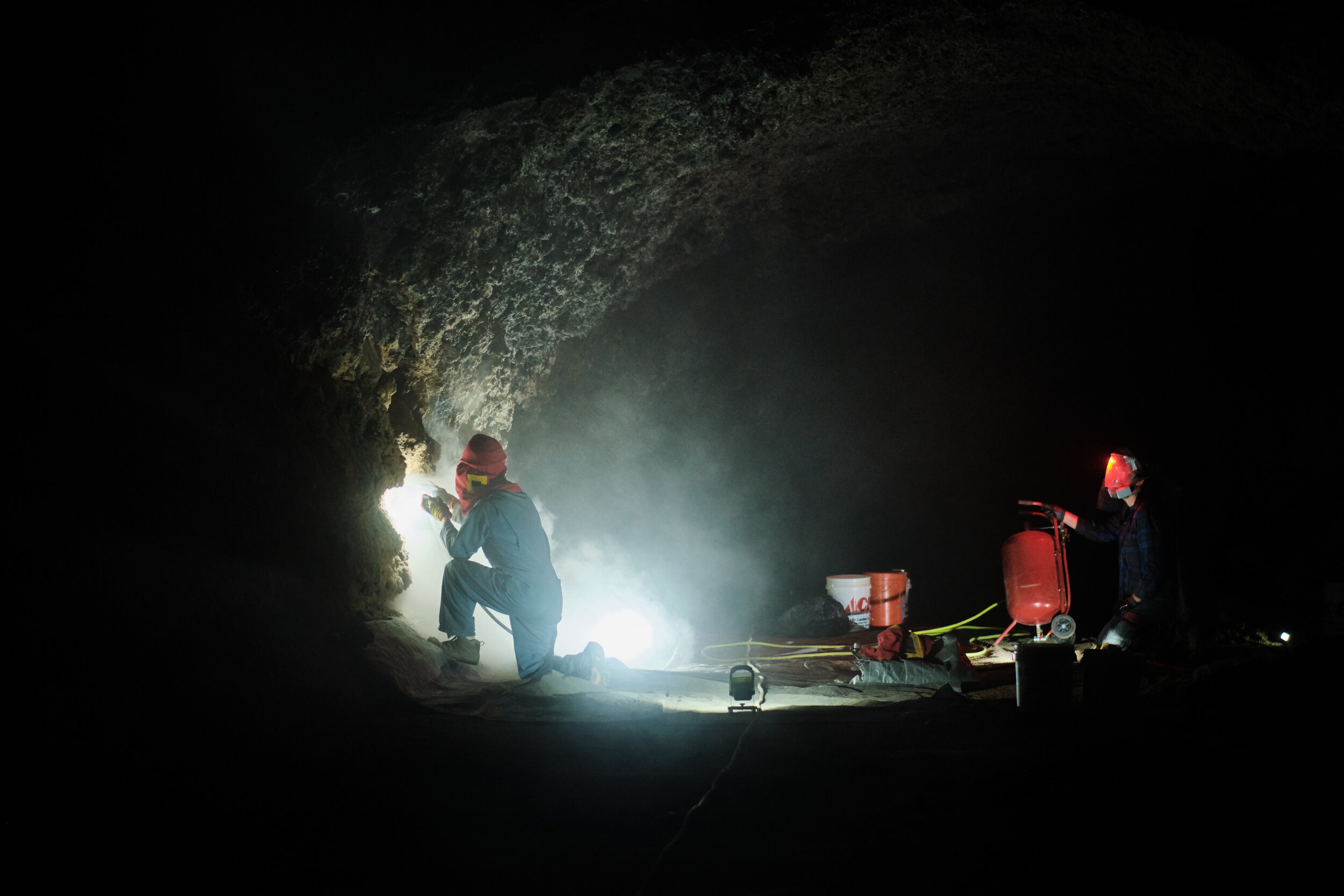 Cave Clean up - Cleaning cave walls - Photo by Drew Pick.jpg