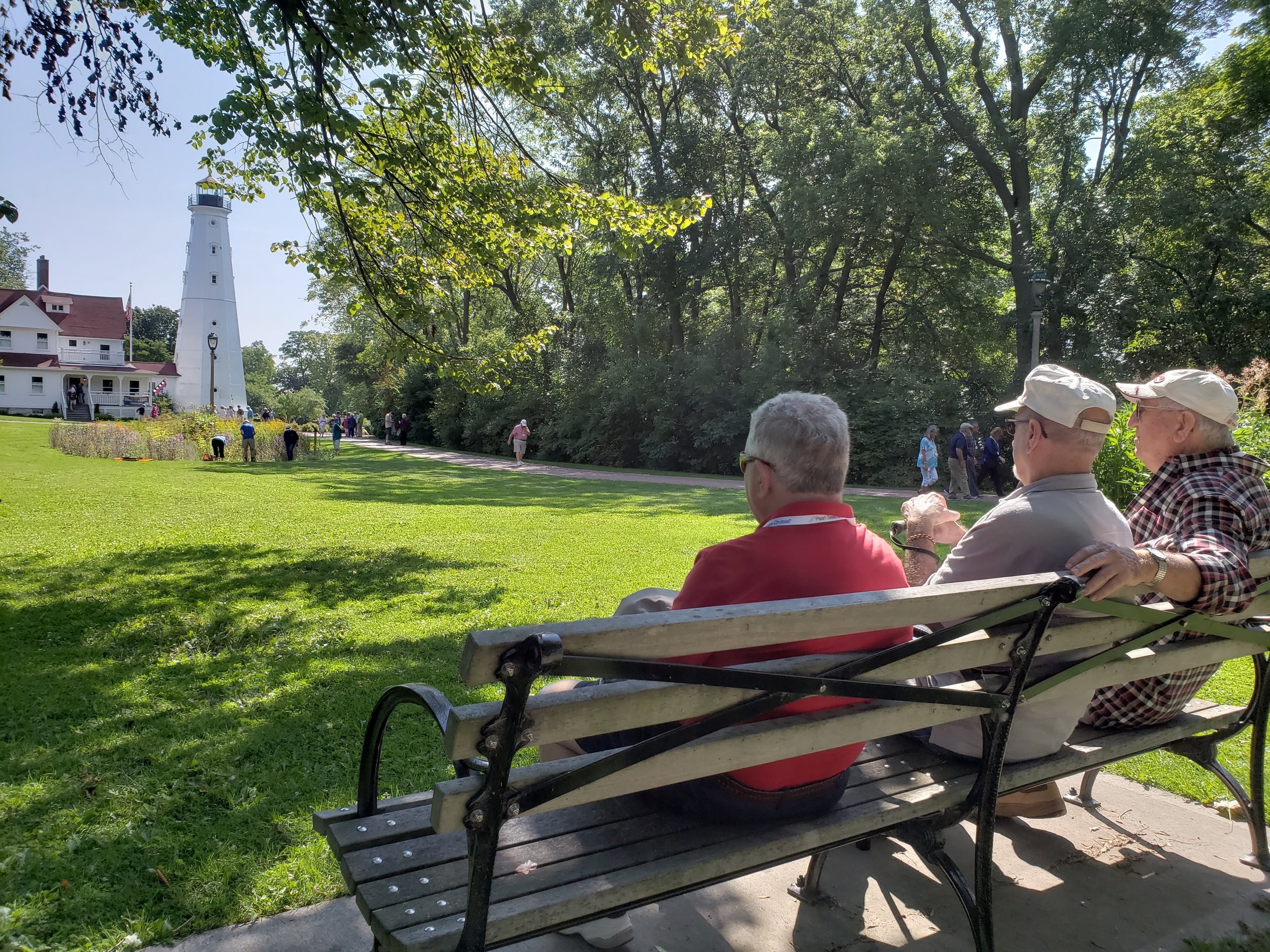 Passengers sit back to enjoy an overlook at the North Point Lighthouse while touring town with Milwaukee Food & City Tours.