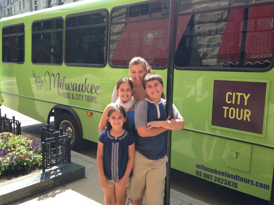 GERMAN EXCHANGE STUDENT EXPLORING MILWAUKEE WITH THEIR HOST FAMILY ON THE HOP ON HOP OFF SIGHTSEEING BUS TOUR IN DOWNTOWN MILWAUKEE.