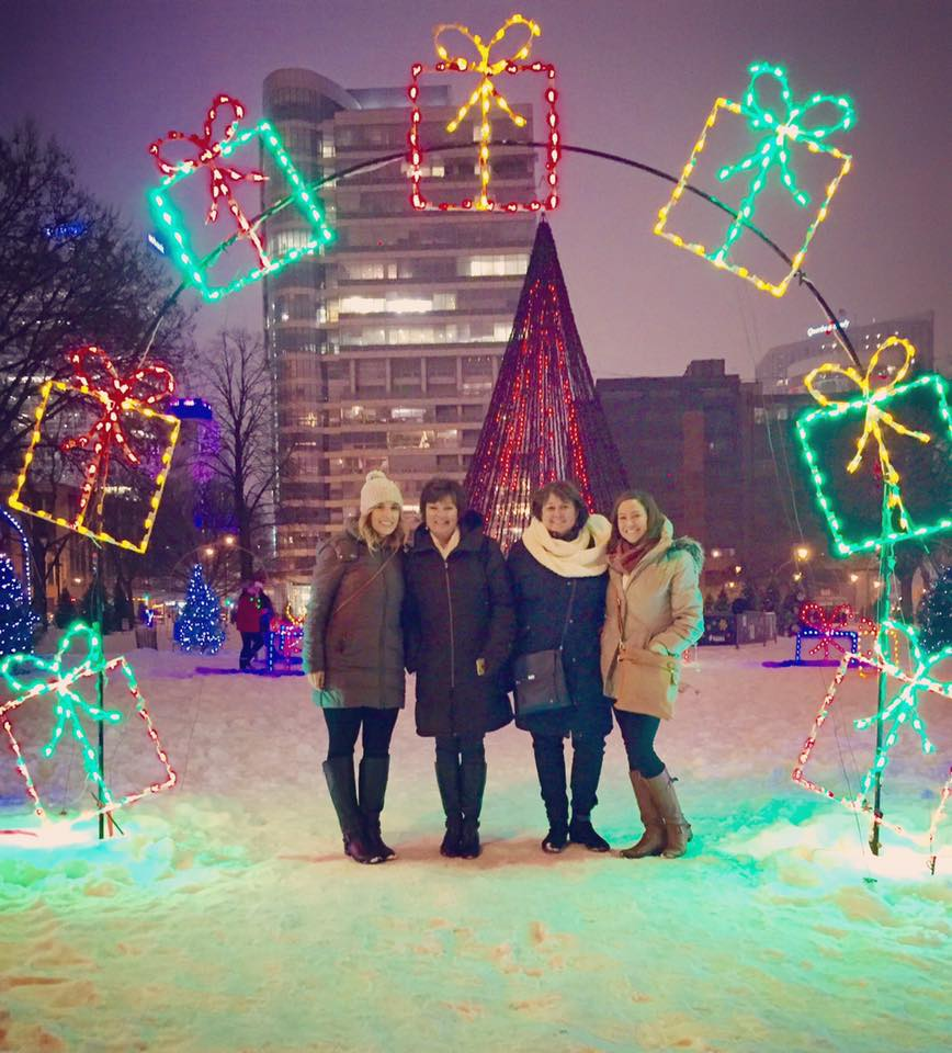 Guests on the Christmas Lights & Desserts tour offered by Milwaukee Food & City Tours enjoying the twinkling lights in Milwaukee's Cathedral Square