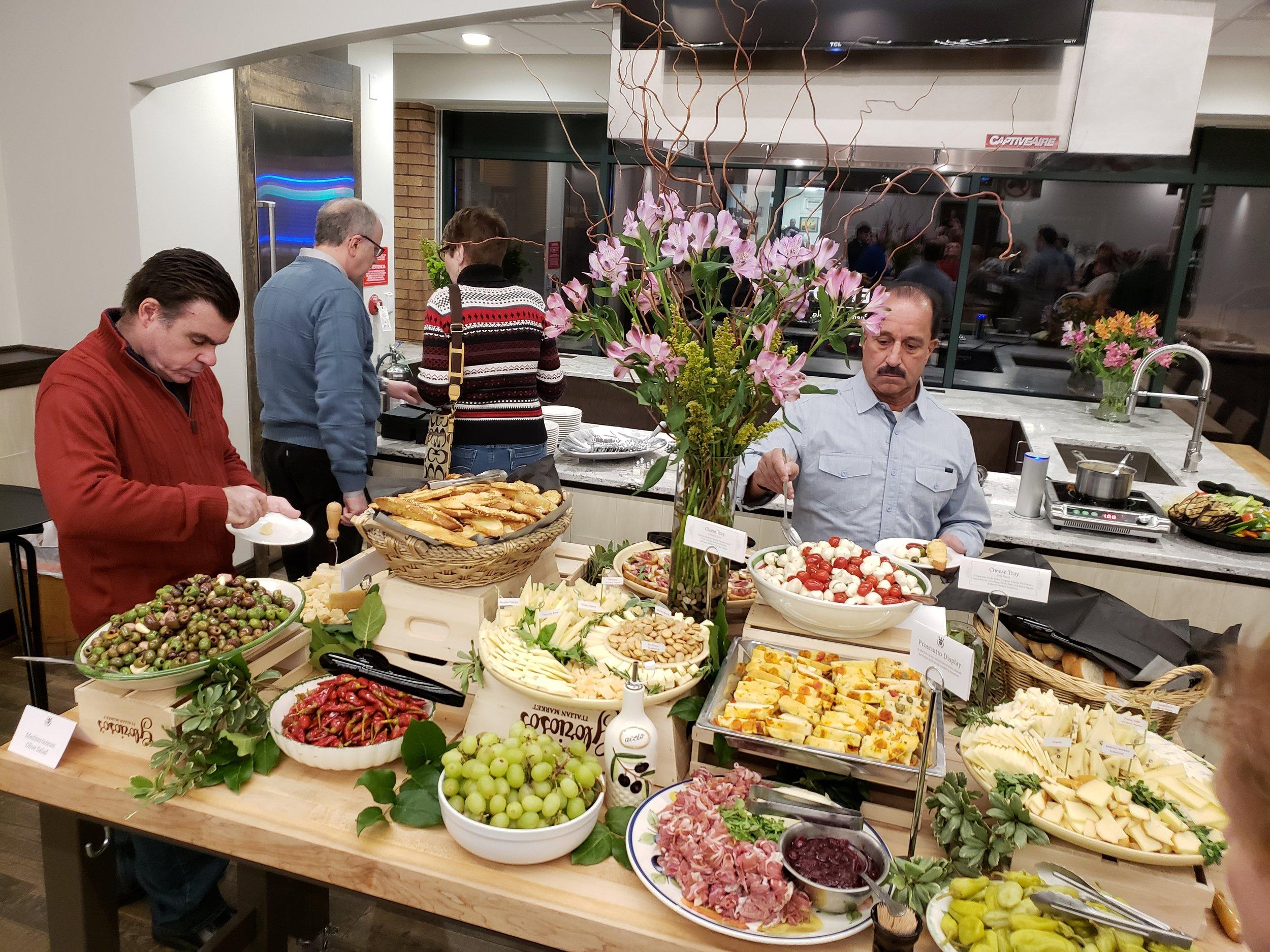 The demo kitchen at Glorioso's Appetito is a perfect space to enjoy Italian fare Glorioso's Italian Market including Finocchiona and Cranberry Crostini, cheese trays, prosciutto, olives, polenta, and Prosciutto Arancini.