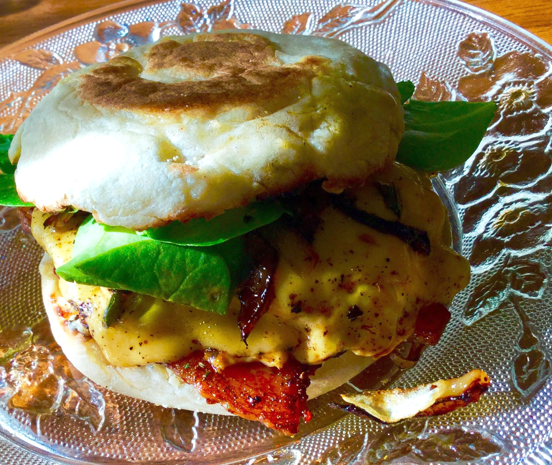 Bacon, Egg & Cheese with Sauteed Onions & Peruvian Green Chili Sauce on an English Muffin! Oh, WOW!