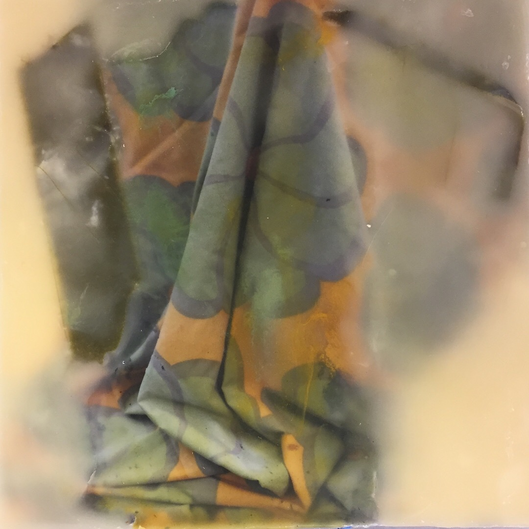Encaustic photograph, cloth, and oil paint on wood