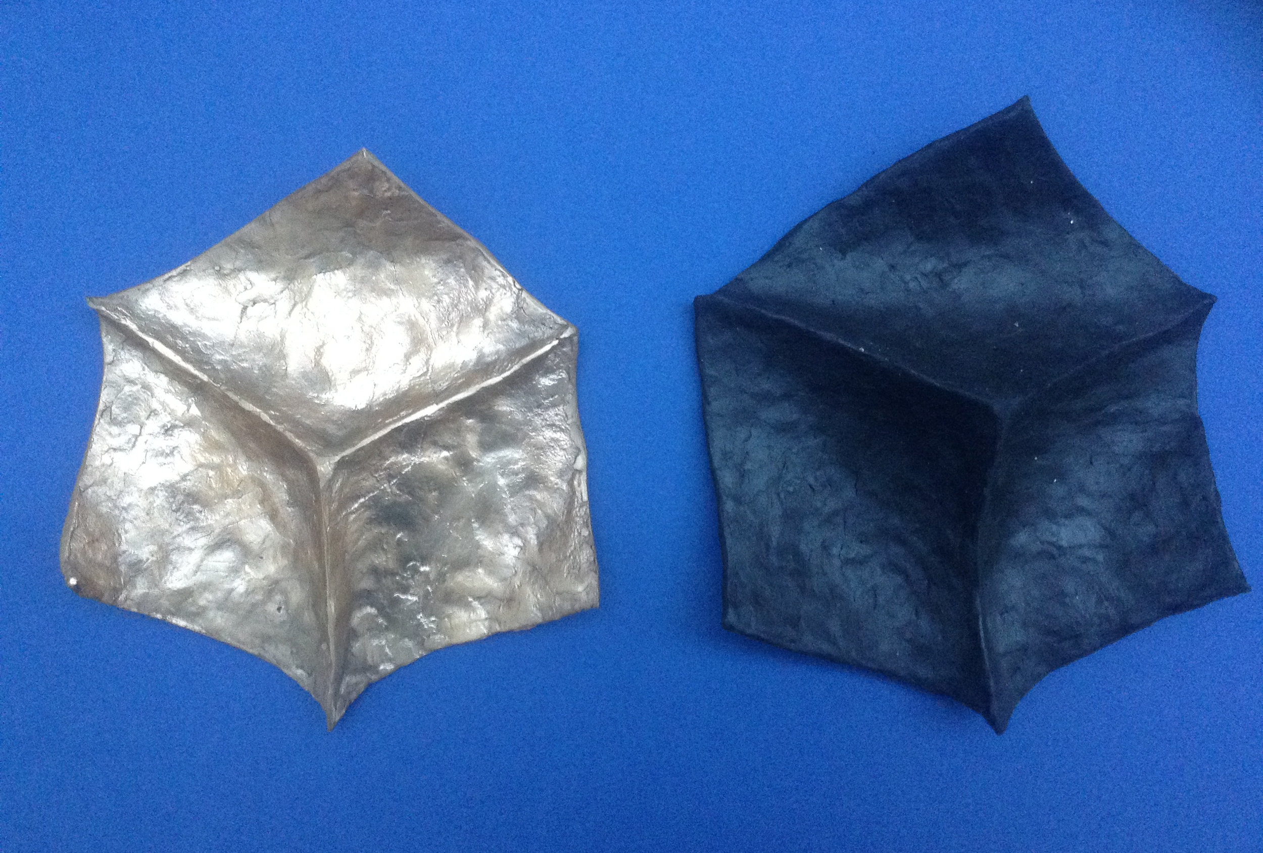 Before and after: cast bronze metal on the left, hand-molded wax on the right (black). Photo by: Mark Andrew Kelly