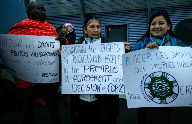 ARTICLE 2 ISSUE. In a silent protest on Friday morning, December 4, the indigenous peoples at COP21 hold placards inside the conference venue, demanding that their rights should remain under the preamble and article 2 of the climate agreement. Photo by Tebtebba