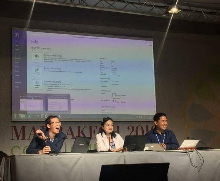 Rodion Sulyandziga; Grace Balawag; and Lhakpa Nuri Goparma Sherpa lead the spirited exchanged at the morning Indigenous Peoples Caucus meeting on Monday at COP22. Photo Credit:India Logan-Riley
