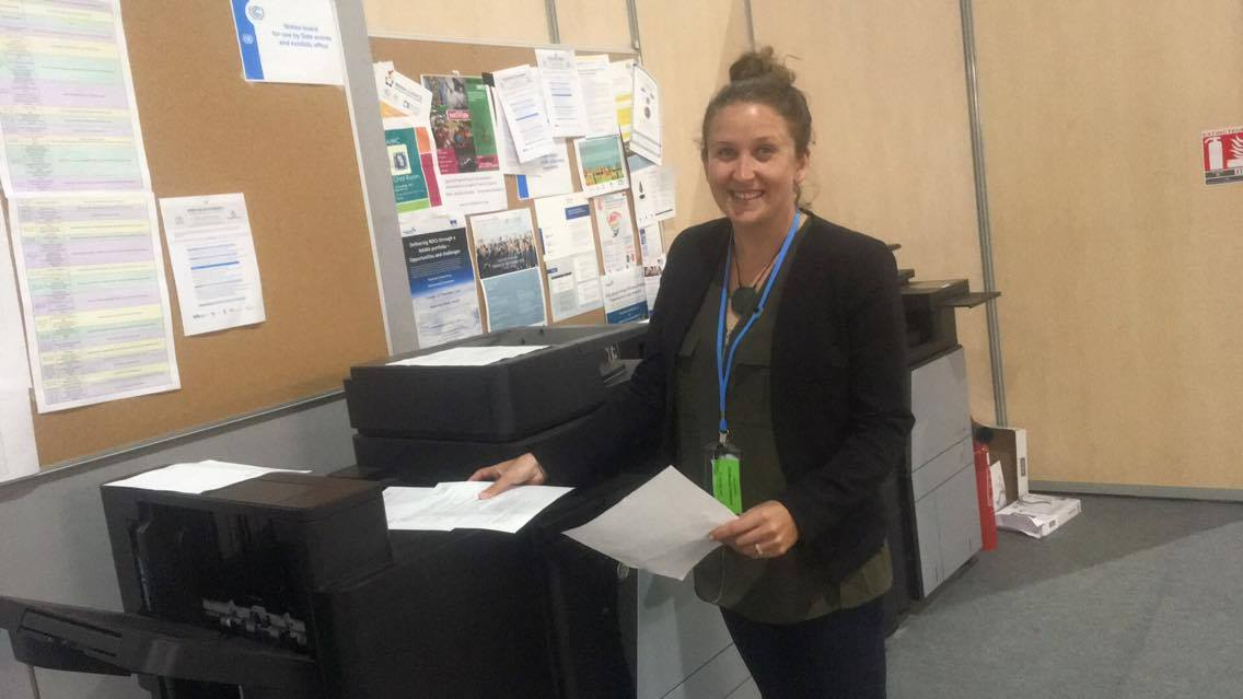 Youth delegate  Genevieve Northey  photocopying the position document of the Indigenous Peoples Caucus for distribution among the delegations at COP22.