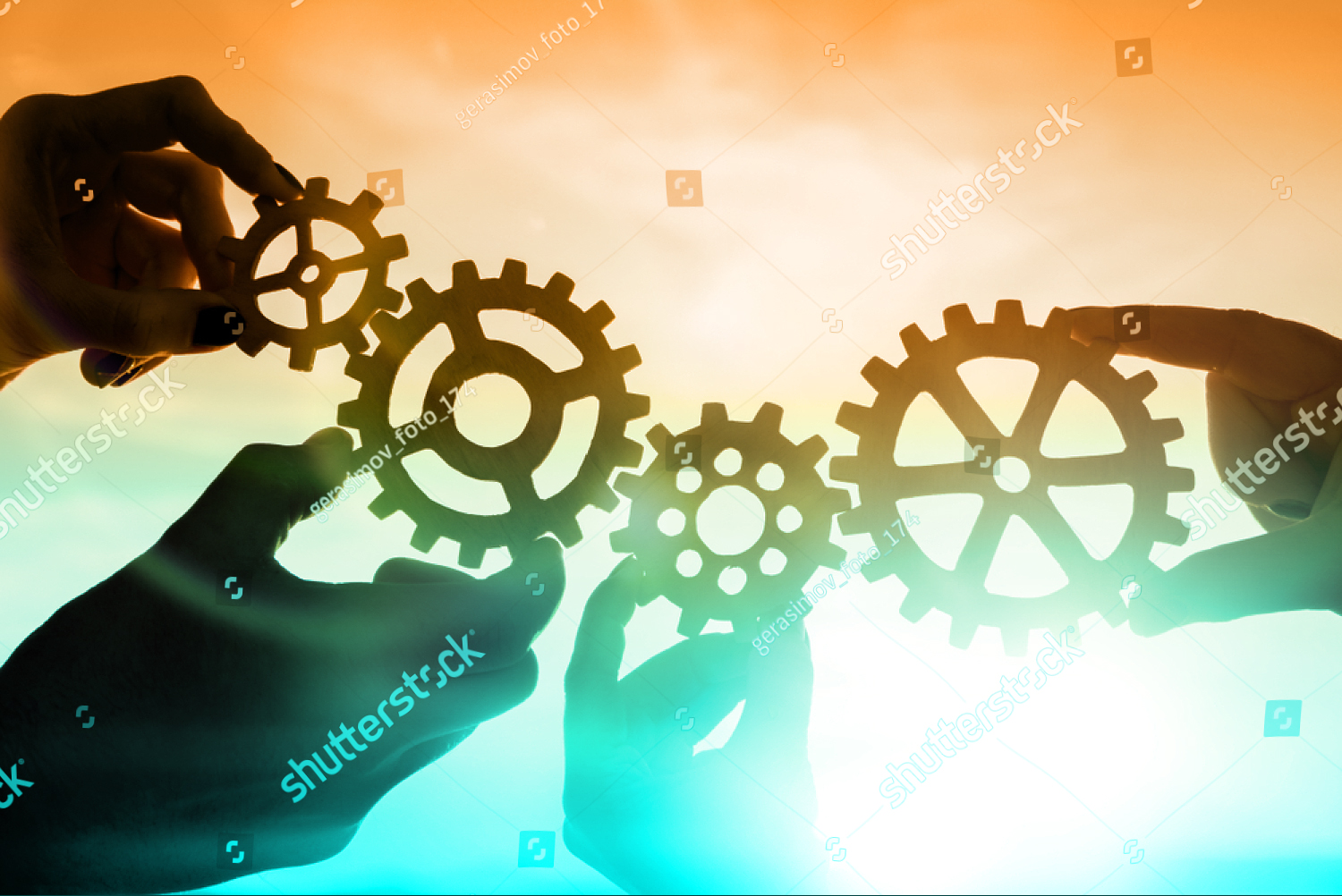 stock-photo-four-hands-of-businessmen-collect-gear-from-the-gears-of-the-details-of-puzzles-against-the-sunset-1172652481.jpg