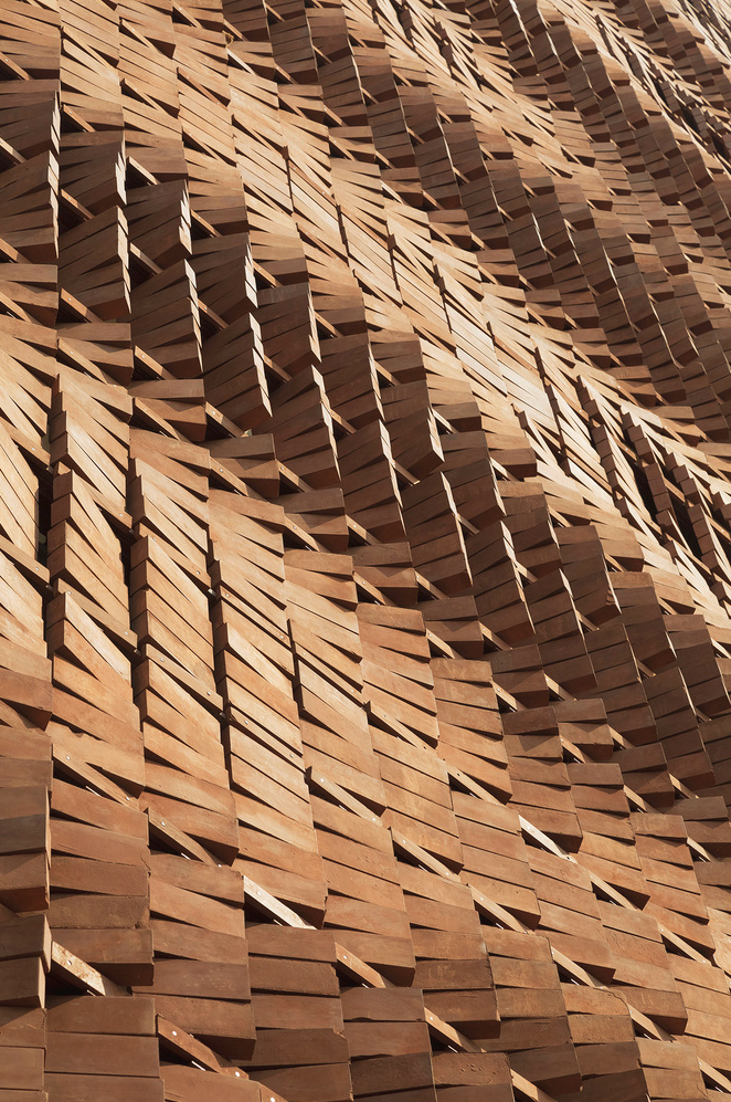 Dynamic detail of the façade of the Cloaked in Bricks by Admun Design & Construction Studio as seen on www.archdaily.com