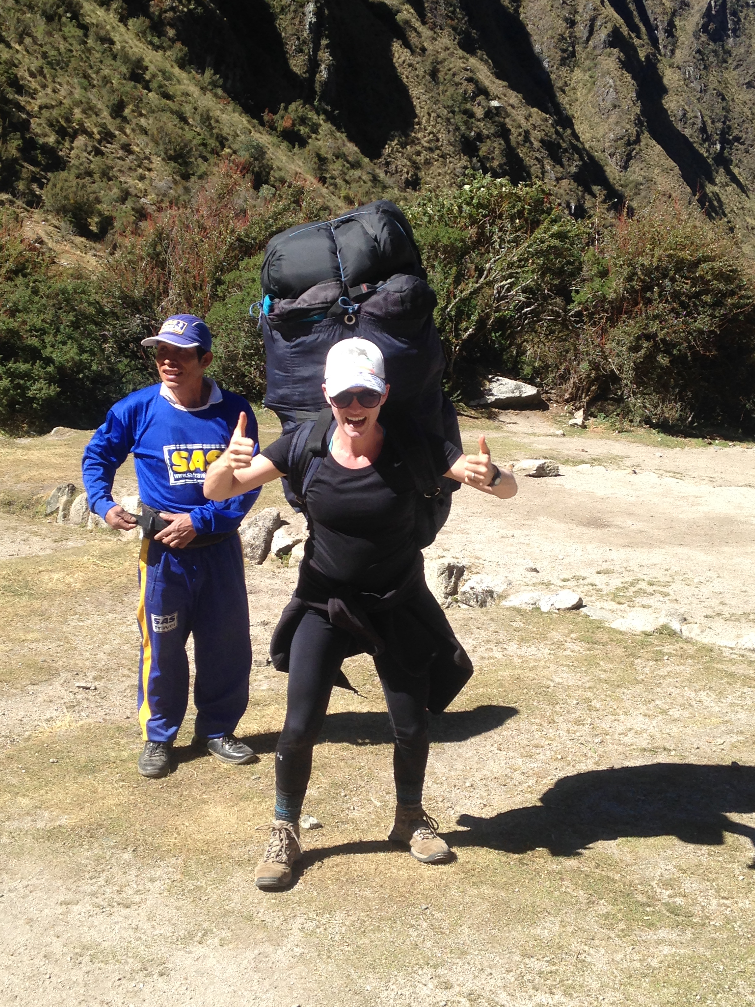 Me trying on the pack the hired porters carry. See that tiny man behind me? He RUNS with this gigantic bag full of hikers' stuff up and down the Inca Trail. Mad respect for these guys.