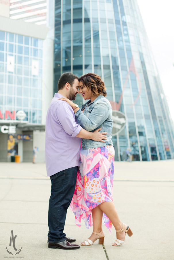 Engaged couple in front of Bridgestone Arena in Nashville, TN