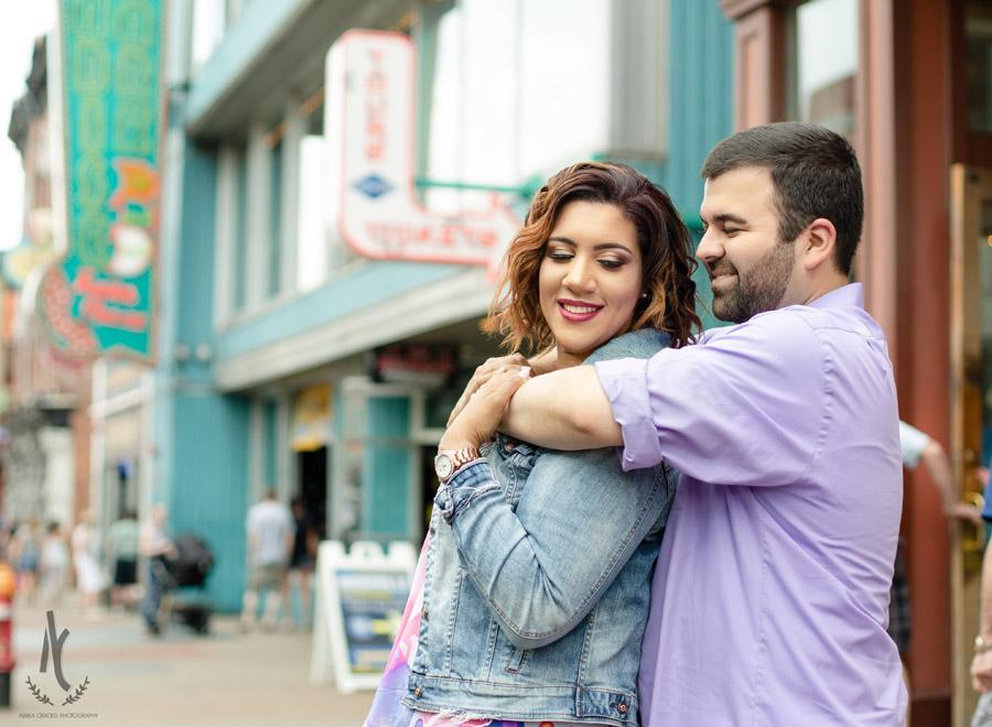 Engaged couple on Broadway Street in Nashville, TN