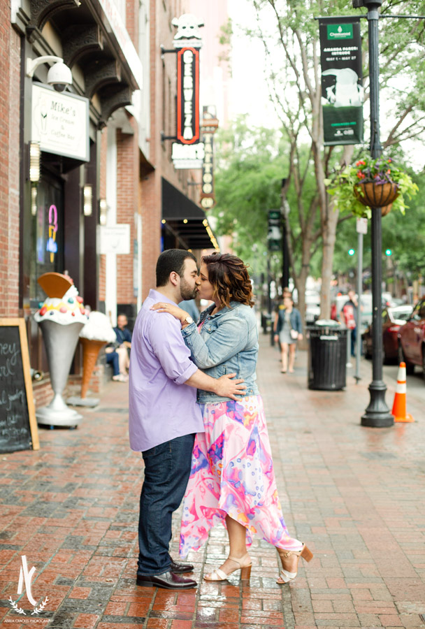 An engaged couple kissing on the street of Downtown Nashville Tennessee