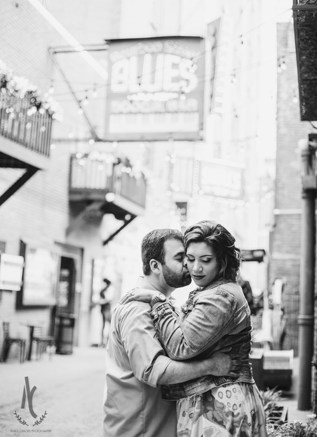 Engagement picture of a couple in Printer's Alley in Downtown Nashville, Tennessee