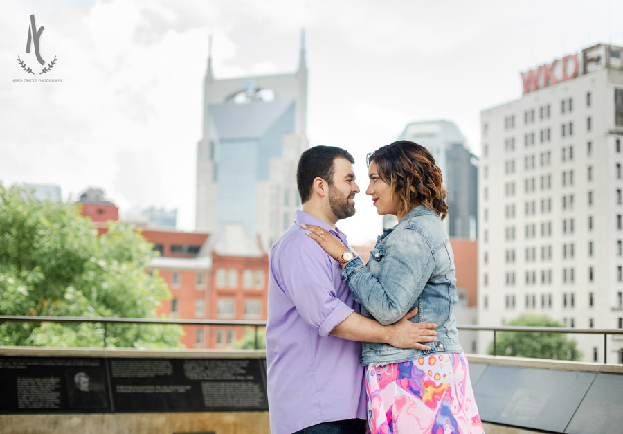 Engagement picture in front of the Nashville Skyline
