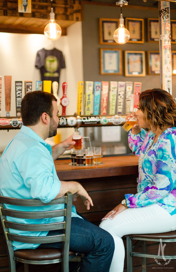 An engaged couple sampling beer at Blackstone Brewery in Nashville, Tennessee