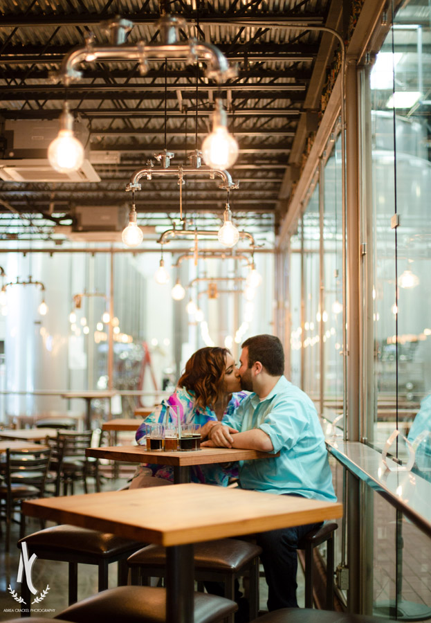 A couple kissing in Blackstone Brewery in Nashville, Tennessee
