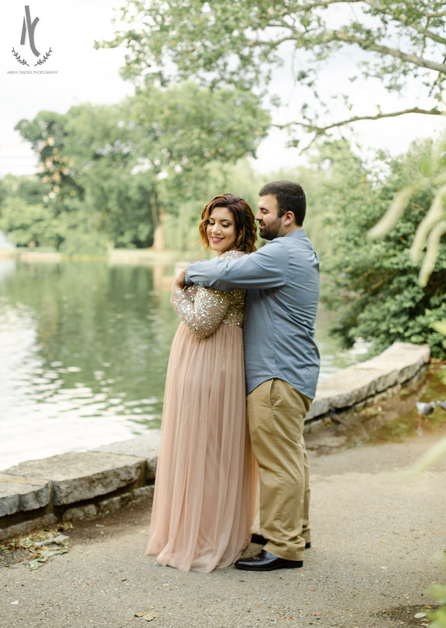 An engaged couple poses naturally at Centennial Park in Nashville, Tennessee